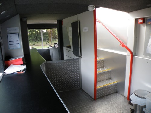 Stairs and the kitchen area at the front of the bus