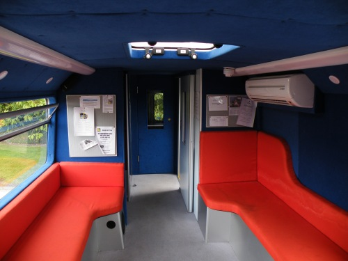front of the top deck, comfy seats,  a 1-1 booth and a wee soundproof music room at the front